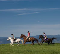Trail riders galloping