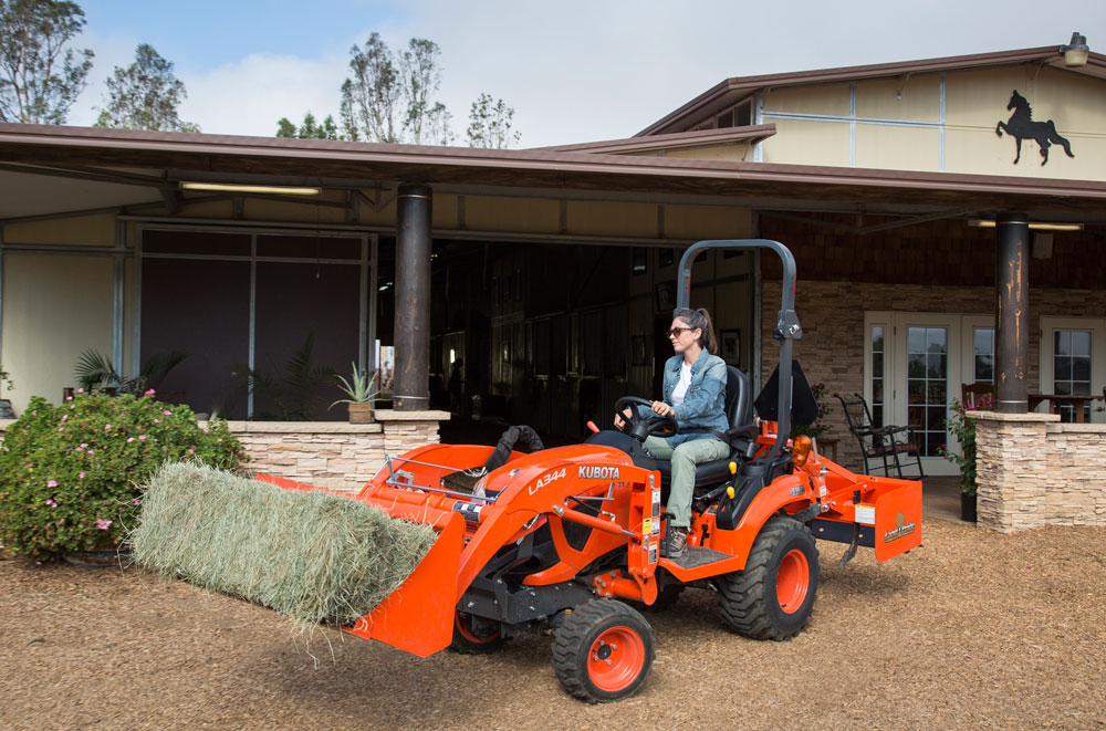 Farm tractor moving hay