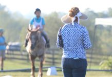Mom and kid at a horse show