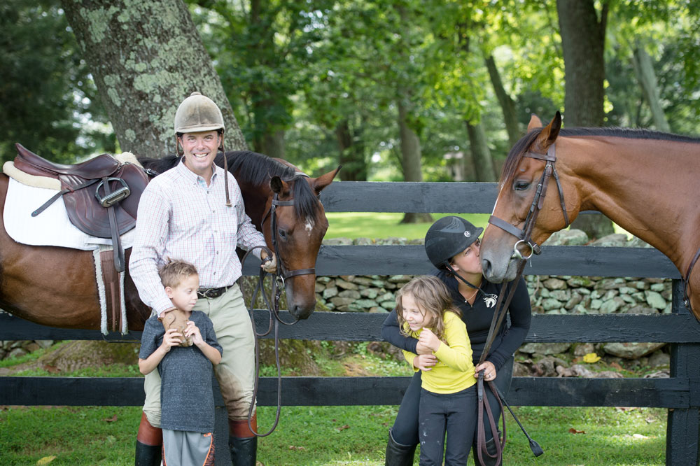 The Mansmann family with two of their Thoroughbreds