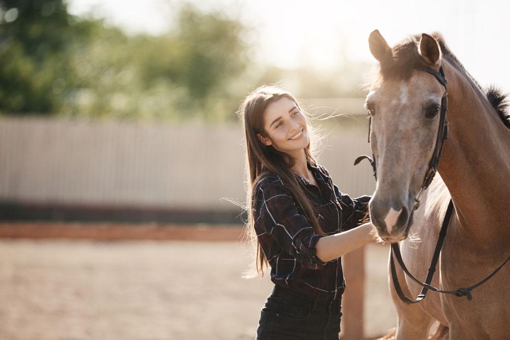 Woman with a buckskin horse