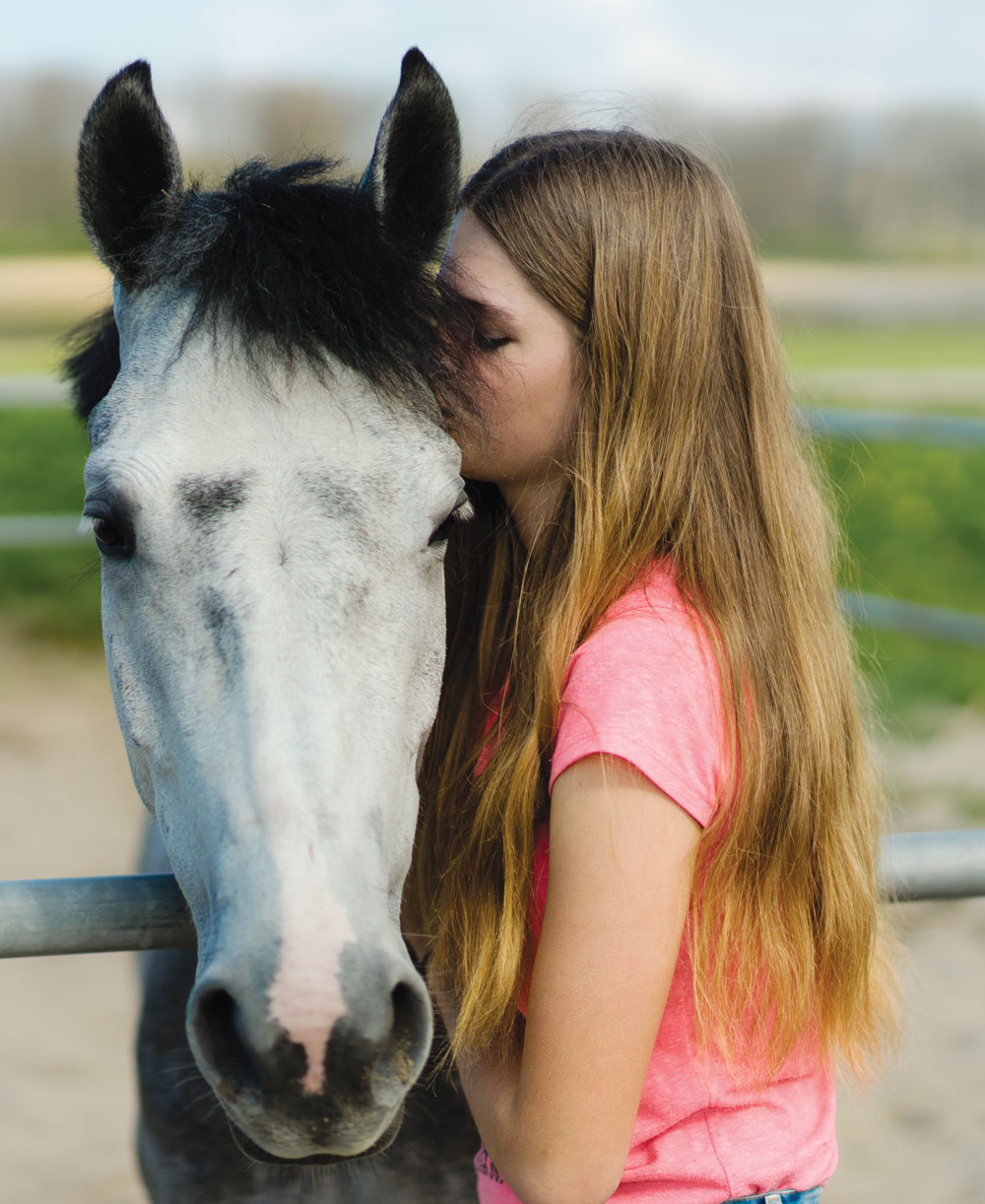 Girl with gray horse