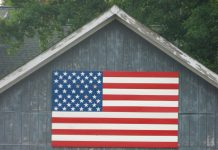 Horse barn with American flag