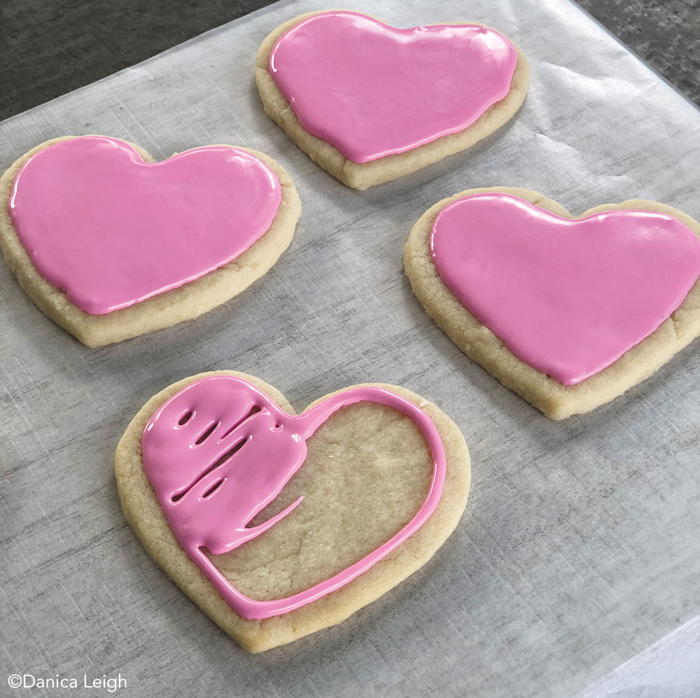 Frosting Valentine's Day cookies
