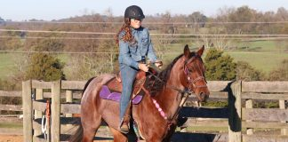 Riding a barrel racing horse outside the arena
