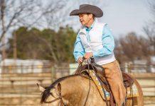 Brenda Hilgencamp riding a buckskin horse