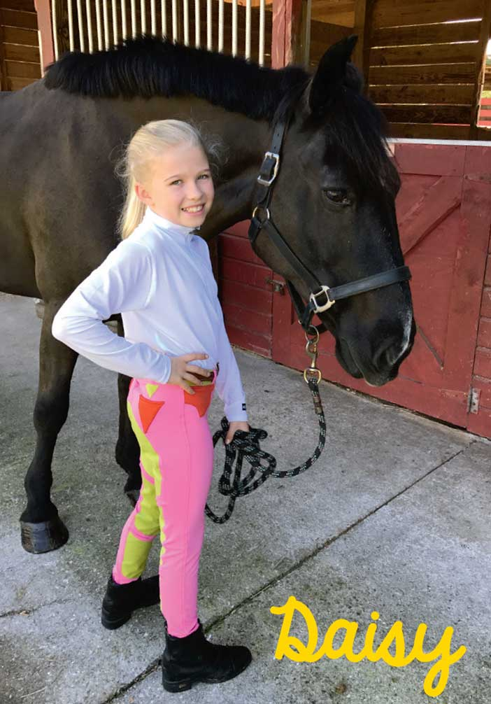 Daisy wearing her winning Kerrits Junior Designer breeches
