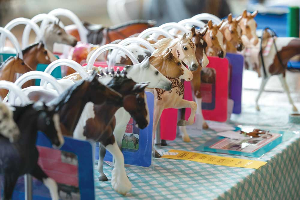 Model horses lined up at a model horse show