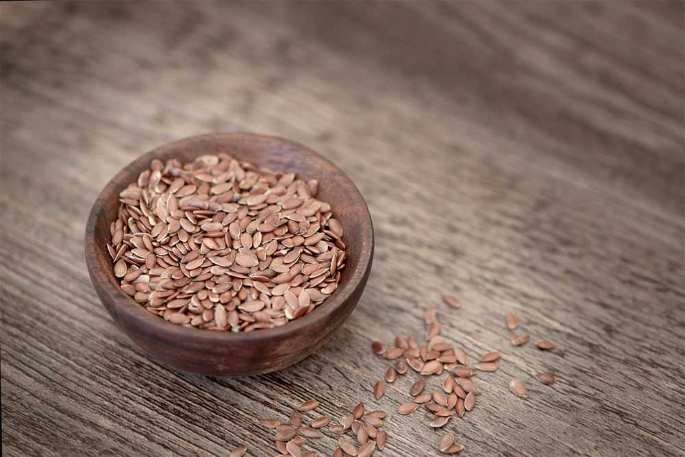 Wooden bowl full of flaxseed