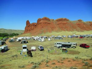 Gathering of people and horse equipment at Big Horn 100.