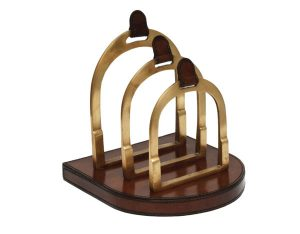 A brass stirrup organizer for adding horse decor to your desk.