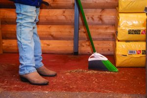 Sweeping up the tack room.
