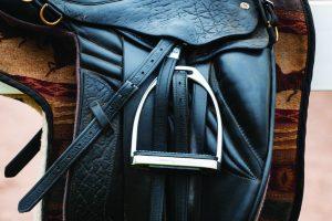 Dressage saddle on fence. Fillis stirrup.