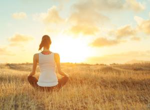 Yoga - Meditation - Woman Sitting in field