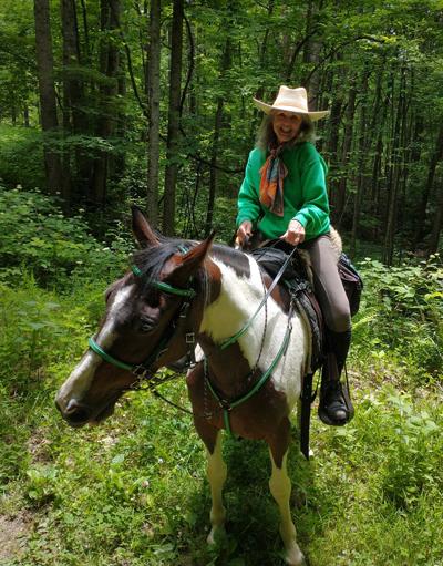 Deirdre Perot on trail horse Boomer