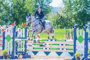 Gracie Elliott Competing in Show Jumping at NAYC