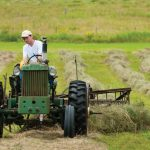 Grow your own hay - Man on tractor
