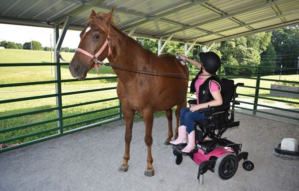 Jewell Cox caring for her horse.