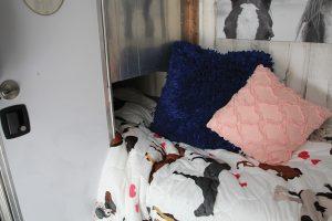 Living area in trailer with bed under under manger