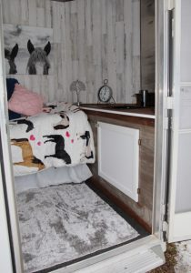 Living area in trailer with sink