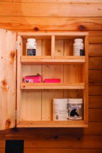 Medicine cabinet in barn tack room.