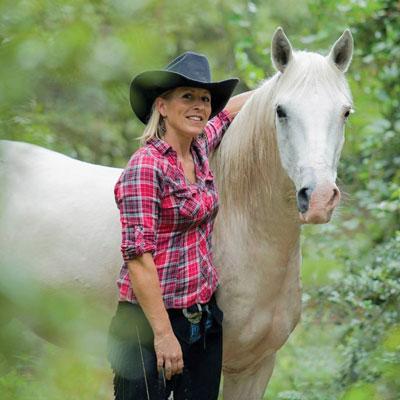 Sandra Williamson and Maxiumus, one of her Mustangs