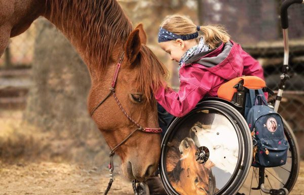Mustang and little girl in wheelchair