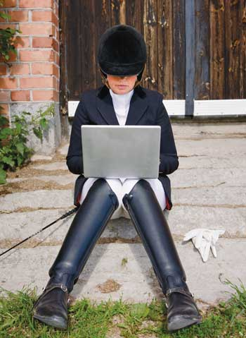 Rider in Show Clothes on Computer