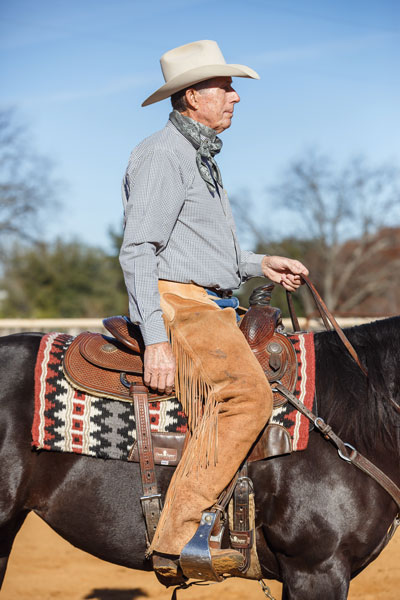 Man in Too Small Western Saddle