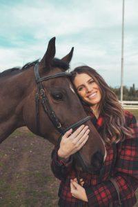 Woman hugging horse.