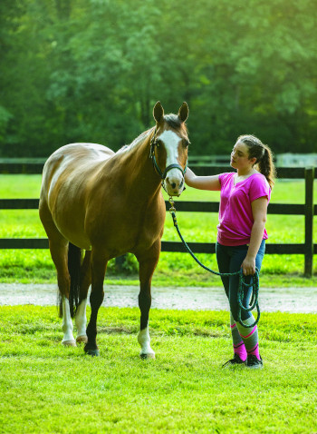 Person with horse practicing easy breathing before riding.