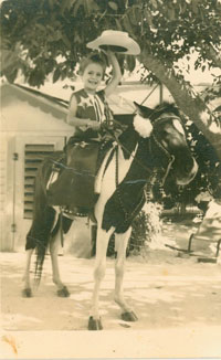 Olympic show jumper Margie Engle at five years old on her pony.